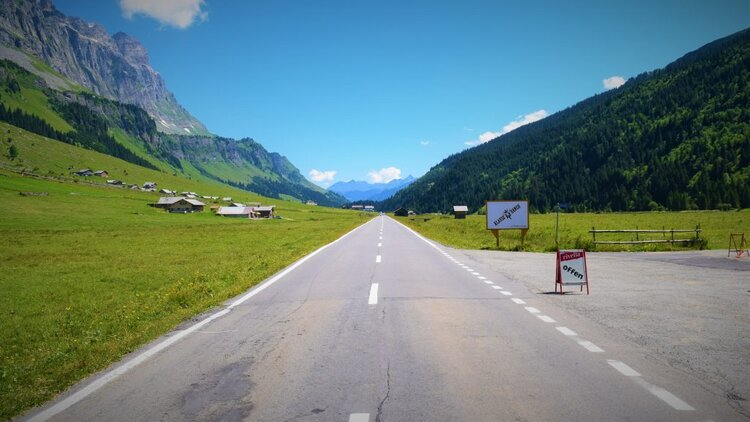 straight road in the alps between mountains