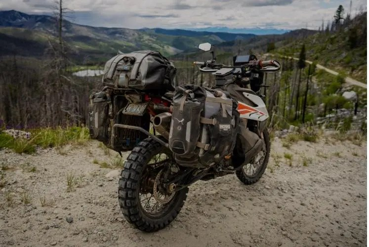 off-road motorcycle in mountains - motorcycle touring style