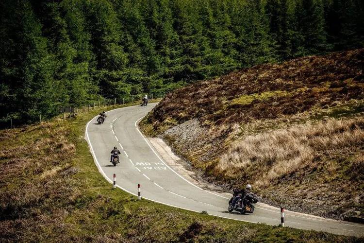 3 bikers riding twisty road in Wales