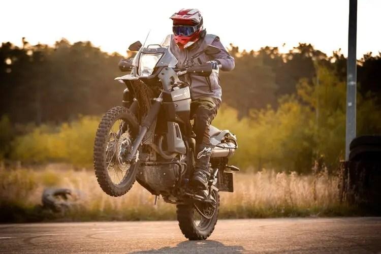 yamaha motorcycle pulling wheelie - motorcycle touring etiquette