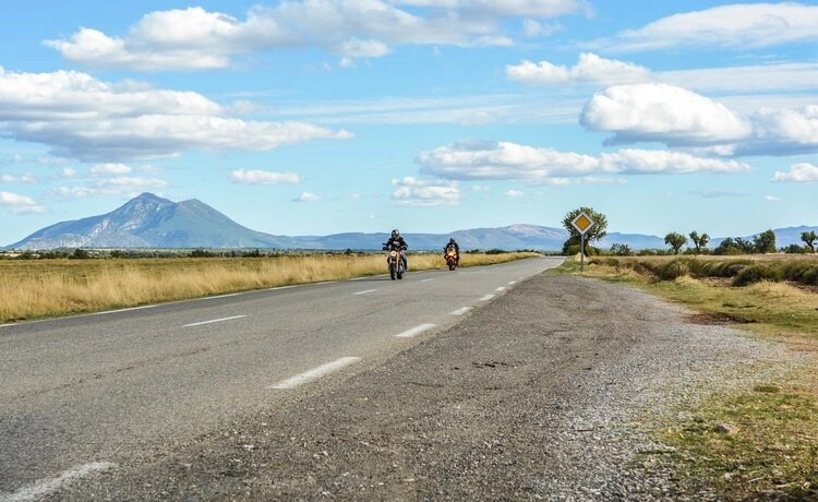 two bikers on mountain road