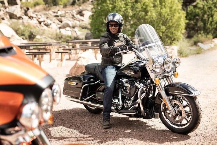 rider on harley-davidson cruiser - motorcycle travel