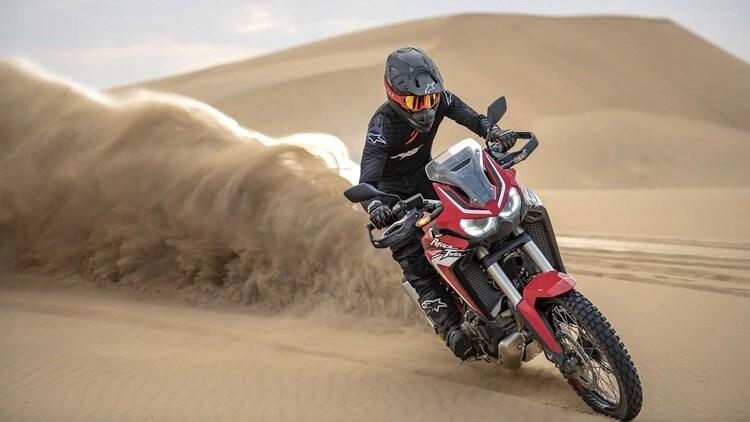 honda africa twin in the desert - quietest motorcycle helmets