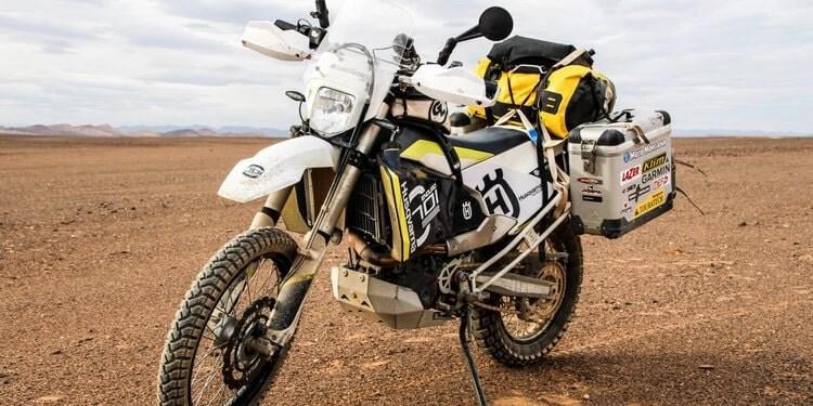 husvarna 701 in desert - best motorcycles to tour around the world