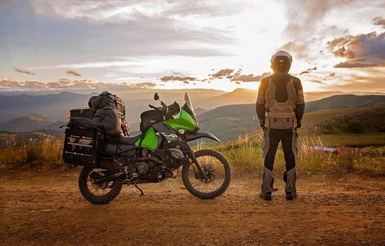off road biker at sunset - motorcycle travel