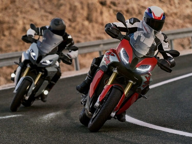 two bmw s1000xr's on mountain road