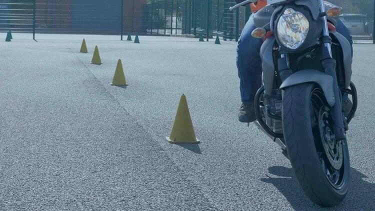 motorcycle slow riding around cones