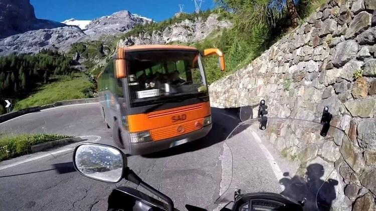 traffic on stelvio pass - cornering a motorcycle