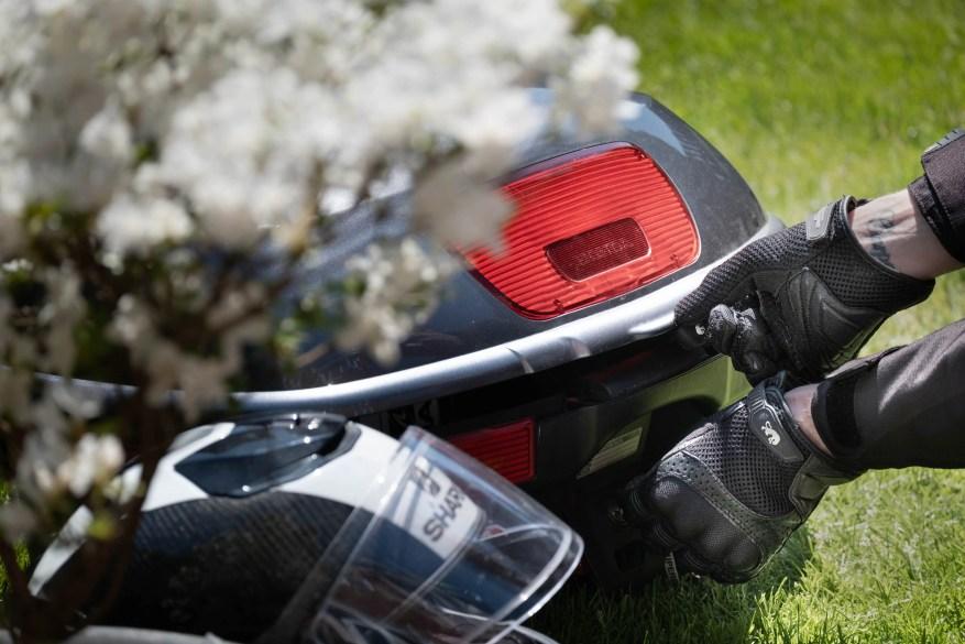 motorcycle gloves, panniers and helmet