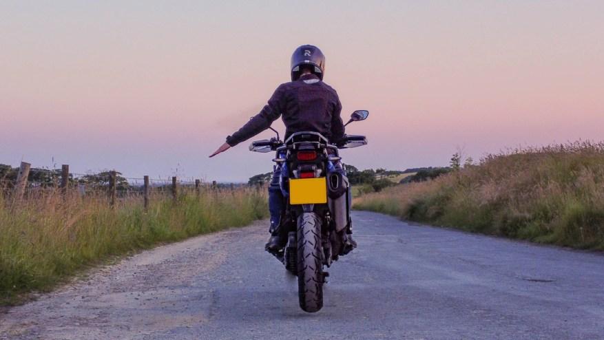 biker code hand signals - slow down