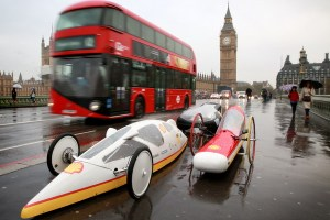 EDITORIAL USE ONLY 5 futuristic hyper-efficient cars, designed by students from the UK for the Shell Eco-marathon Ð a competition to see how far the vehicles can travel on 1 litre of fuel, drive over Westminster Bridge in London to mark its arrival to the UK. PRESS ASSOCIATION Photo. Picture date: Wednesday November 4, 2015. This yearÕs event is going beyond the student competition by launching ÔMake the FutureÕ, a public festival to raise greater awareness of the wider energy challenge faced by the UK. The festival will be taking place at LondonÕs Queen Elizabeth Olympic Park from June 30 to July 3 2016. Photo credit should read: Matt Alexander/PA Wire