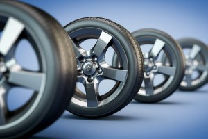 3d illustration of row of car wheels, selective focus.