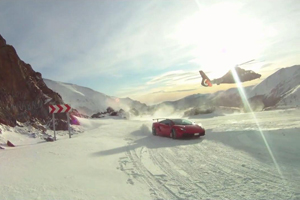 Watch A Gallardo LP570-4 Play with a Helicopter in the Snow