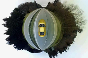 """Porsche Cayman: The world is a curve"""