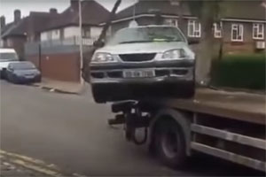 Friday FAIL: Driving off a Tow Truck
