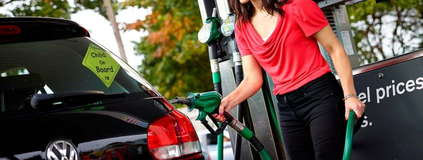 Motorist filling up at fuel station