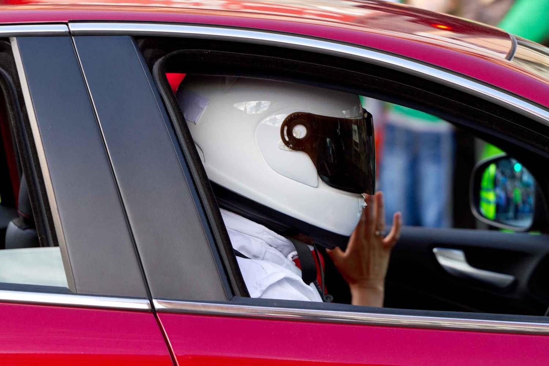 Person in traffic wearing a helmet
