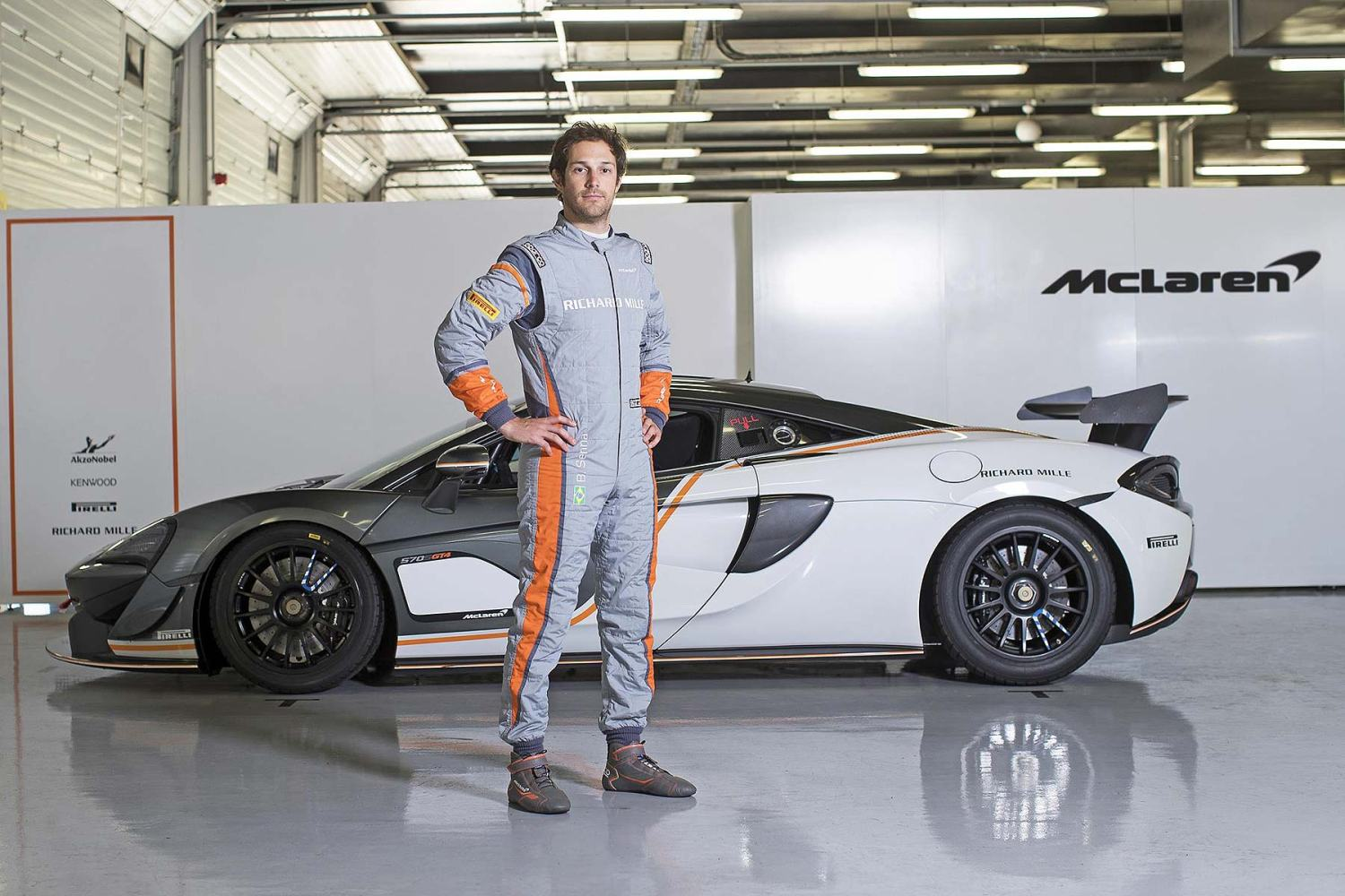 Bruno Senna wears the Sparco McLaren SP16+ race suit in front of the McLaren 570S GT4