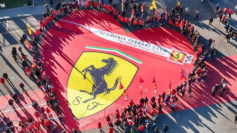 Ferrari fans with the Scuderia logo