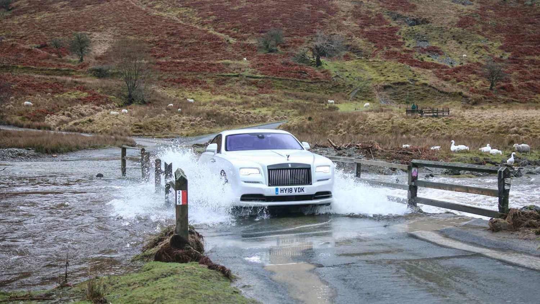Rolls-Royce Wraith Black Badge driving through ford