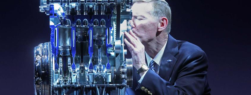 Ford chief Alan Mulally kissing the Ford 1.0-litre Ecoboost engine