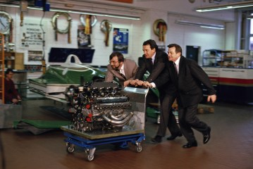 Hans-Joachim Esch, Helmut Flegl and Hans Mezger (f.l.t.r.) with the engine Type 2708, 1990.