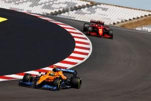Carlos Sainz, Ferrari SF21, leads Lando Norris, McLaren MCL35M leaving corner