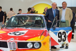 © BMW AG - Foto Uwe Fischer / Hervé Poulain und Jochen Neerpasch, die Gründerväter der BMW Art Car Collection, an dem BMW Art Car von Alexander Calder in der Sonderausstellung zu den BMW Art Cars beim Concorso d'Eleganza (05/2015)