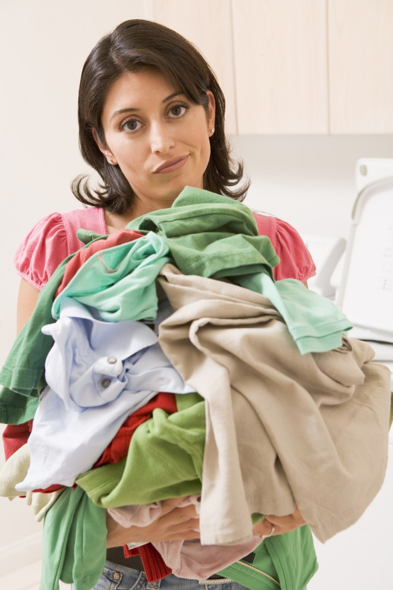 Laundry Chores Cleaning Domestic Frustrated Housework Unhappy Woman 30s Thirties Mid Adult Casual Clothing Color Colour Image Domestic Life Holding Home Indoors Inside Latin American Latino Hispanic Laundry Room Looking At Camera One Person Overwhelmed Ov