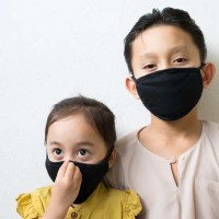 two children wearing face masks
