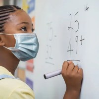 elementary girl wearing a mask at school