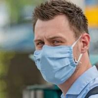 man wearing face mask looking at camera