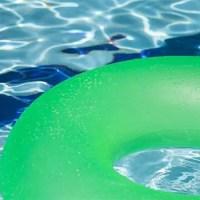green innertube in swimming pool