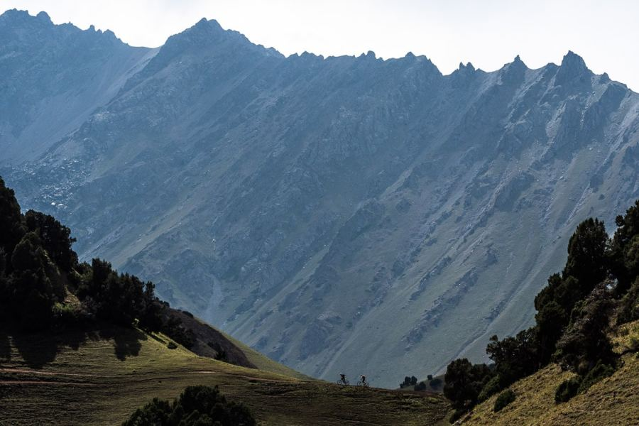 Feeling small against the landscape whilst Mountain biking in Kyrgyzstan