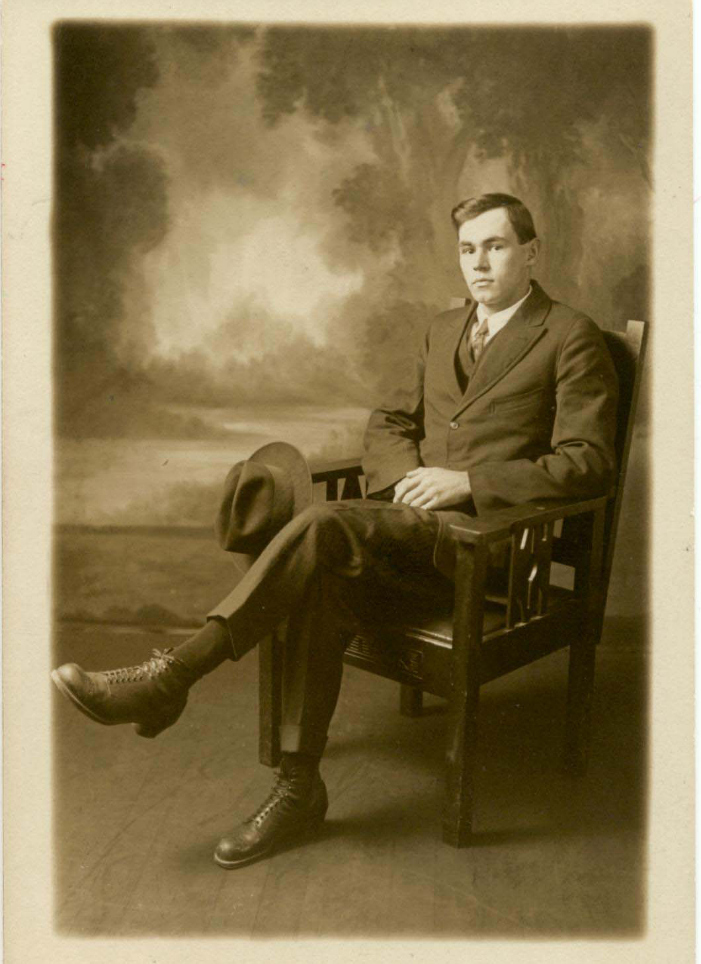 "Studio portrait of Frank Tapley seated in a chair, 22 years old. Annotation on verso: ""Frank 1920"". Photo courtesy Whistler Museum."