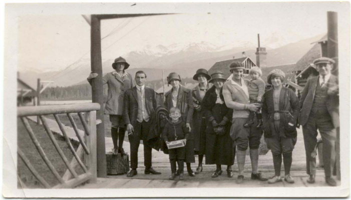 Photograph of the Tapley family at Rainbow Lodge: From L-R: Jean, Phil, Edith with Frank Tapley Jr; two unknown women, Virginia, Margaret Esworthy (nee Tapley) & Sewall Tapley. Photo courtesy Whistler Museum.