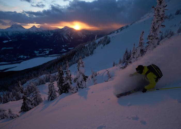 KC Deane racing the sunset in Revelstoke, BC. Photo: Grant Gunderson/courtesy Eddie Bauer.