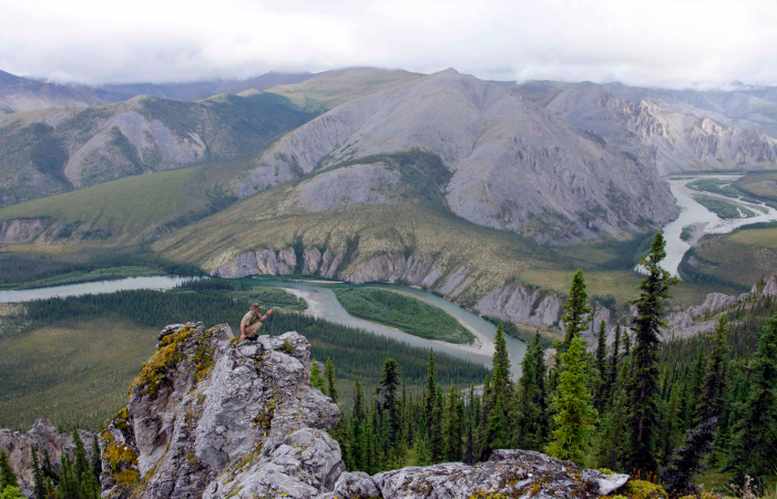 Scenic Highlight of the Hart River. Marten Berkman on a ridge overlooking the canyons, gendarmes, and castellated ridges near Mount Netro. Photo by Juri Peepre/courtesy ProtectPeel.ca