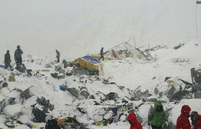 In this photo, provided by climber Azim Afif, people approach the scene after an avalanche triggered by a massive earthquake swept across Everest Base Camp, Nepal on Saturday. Afif and his team of four others from the Universiti Teknologi Malaysia all survived the avalanche. Photograph: Azim Afif/AP