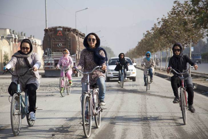 A group of women rides through the busy streets of Kabul with the goal of normalizing the image of girls on bicycles. Jenny Nichols photo.