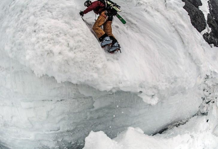 """This was a 20-foot deep avalanche runnel on Chatyn-Tau's southeast couloir. Peter ran down it as fast as his tired legs could safely carry him. We'd been on the move for over 12 hours here and our senses were dulled by the hours of stress involved in skiing and downclimbing steep or near vertical ice. An avalanche could've come down at any moment but this runnel was the lowest and easiest point to be able to jump over the bergschrund."" TREVOR HUNT PHOTO."
