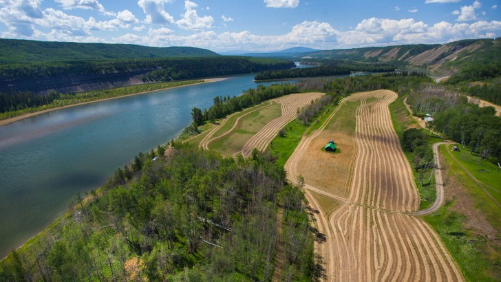 The annual Paddle for the Peace, drawing stakeholders, protesters and concerned citizens since 2005, passes by a productive farmland. Agronomists have calculated that the farmland to be submerged by Site C could feed a million people. GRAHAM OSBORNE PHOTO