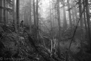 Uwe Homm tackling a steep loamy chute high in the hills above Squamish, BC. Rider: Uwe Homm. Location: Squamish, BC.