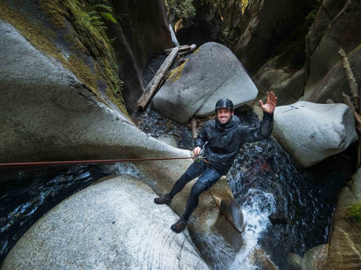 Ricky dropping into Box Canyon on the Great Trail in Squamish, BC