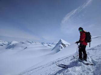 Heli ski guide at the top of a run