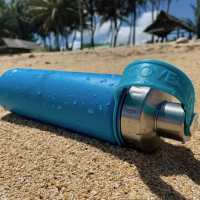 EcoVessel Water Bottle on the beach.