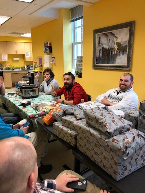Engineers wrapping gifts