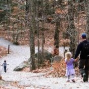 family hiking on trail in Fall
