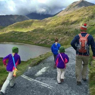 three children and father hiking up mount snowdon