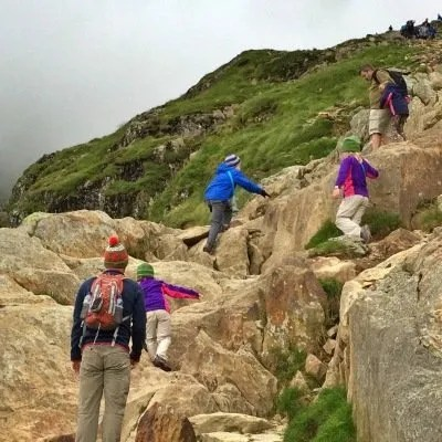 climbing up rocks of mount snowdon